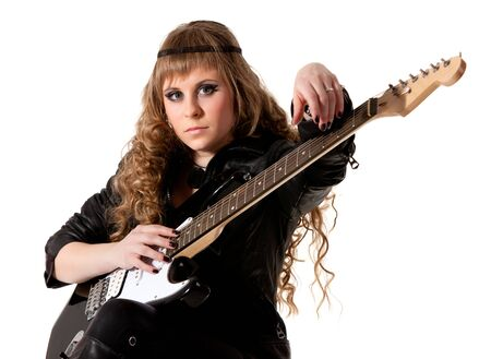 Woman squatting and clutching guitar