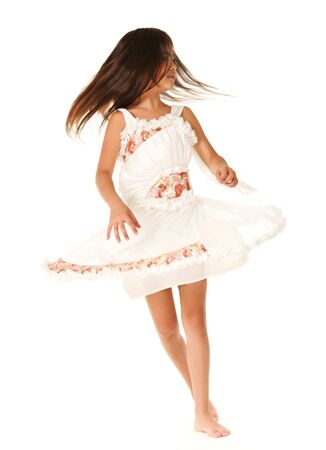 Dancing girl dressed in white blouse, isolated on white background