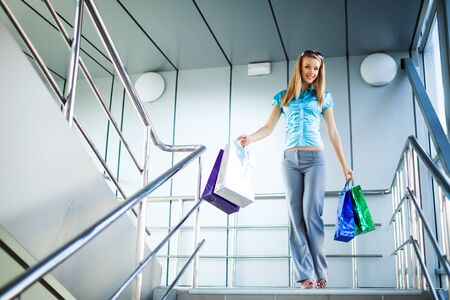 Women going down stairs with shopping bags in hands