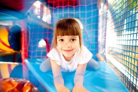 Girl laying in colorful playground