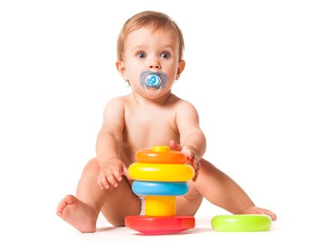 Cute baby playing with toy. Stock Photo