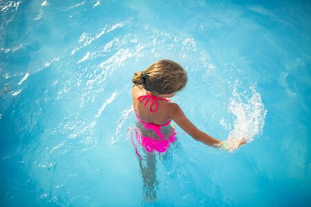 Top view happy little girl in bright swimwear