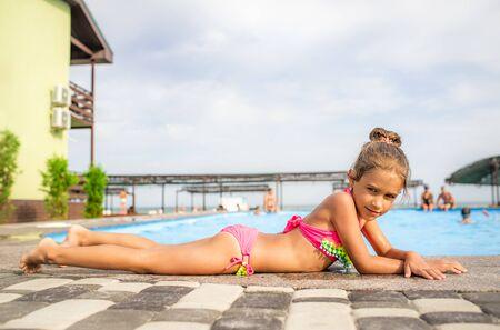 Cute little girl in pink bathing suit