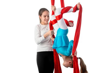 Teenage girl helps her little sister
