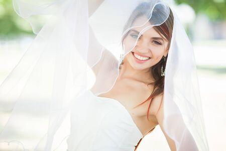 Beautiful bride wearing white veil.