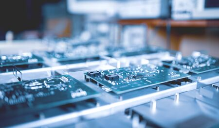 Close-up computer green microcircuits lie row after row in the industrial production of computers and office equipment. Concept of developing new technologies and storing information Stock Photo
