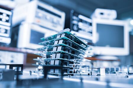 Microchips are stacked on top of each other on metal plates in the manufacture of super modern powerful computer equipment for a modern cardiology clinic. Powerful specialized computers concept