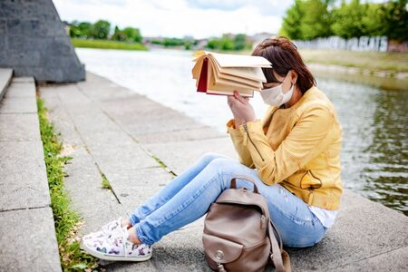 Sad young woman in casual clothes and protective mask Reklamní fotografie