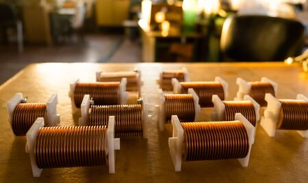 Close-up of high-frequency powerful copper wire on background of laboratory. Concept production of super modern high-tech components for transceiver appliances Stock Photo