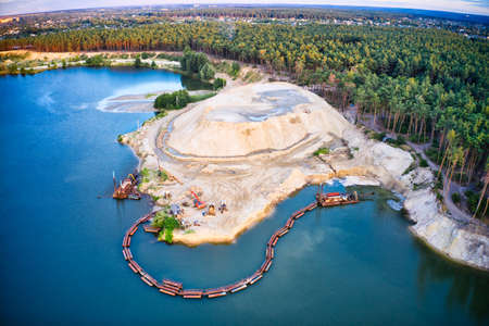 The station for the extraction and cleaning of sand stands about and in the lake