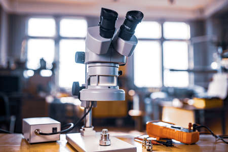 Large modern electron microscope in the research laboratory Фото со стока