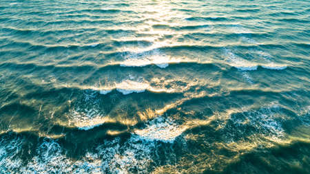 Aerial view waves on sand beach. Sea waves on the beautiful beach aerial view drone 4k shot.