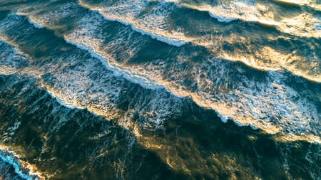 Aerial view waves on sand beach. Sea waves on the beautiful beach aerial view drone shot.