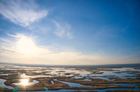 Irresistible floods on the Samara River on the Dnieper in Ukraine in the evening warm bright light. Aerial panoramic drone shot