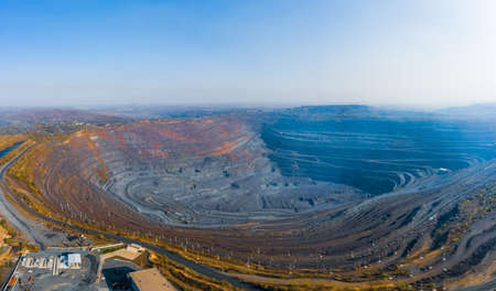 Extraction of minerals with the help of special equipment in the warm evening light in picturesque Ukraine. Aerial panoramic drone shot