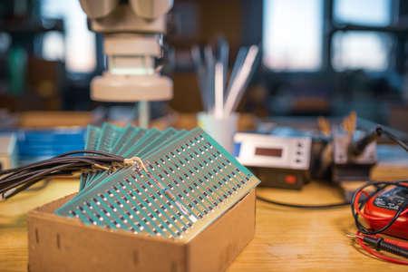 Close-up side view of a panel of SMD resistors Фото со стока