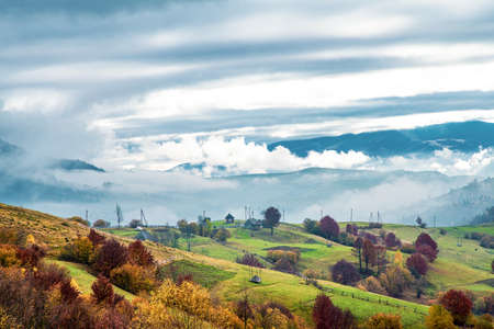 Beautiful nature of the carpathians in the hills of the sky, forests and a small village Standard-Bild