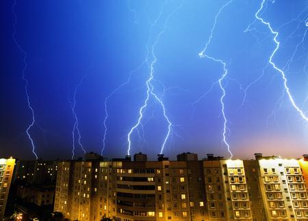 Lightning and thunderstorm above night city
