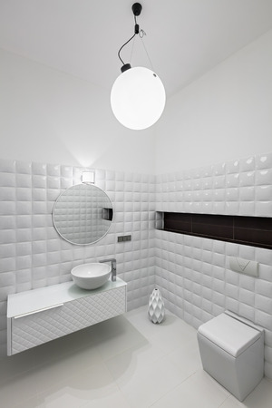 Interior of modern restroom in white colors Stock Photo