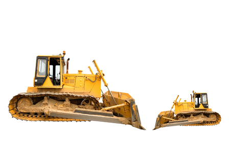Two heavy dirty building bulldozers of yellow color: big and small, isolated on white.