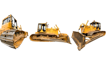 Composition with heavy dirty building bulldozers of yellow color, isolated on white. Stock Photo