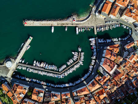 Old city Piran in Slovenia, aerial marina view in the morning.