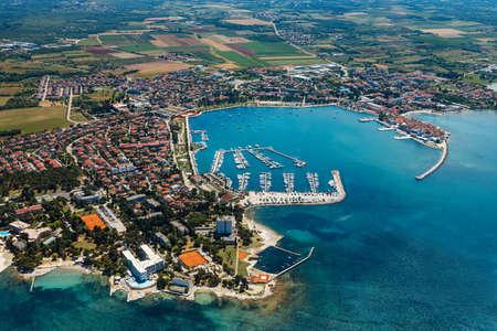 Old coastal city Umag in Croatia, aerial panoramic view. Istria, Europe.