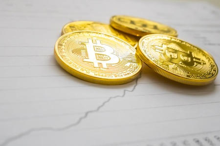 A golden bitcoin on graph background. trading concept of crypto currency Фото со стока - 63025255