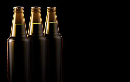 stout: Close up bottles of beer on a black background.