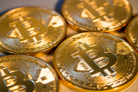 Photo Golden Bitcoins On Blue Background. Trading Concept Of Crypto Currency Stock Photo