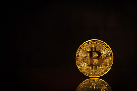 Photo Golden Bitcoins On Black Background. Trading Concept Of Crypto Currency Stock Photo
