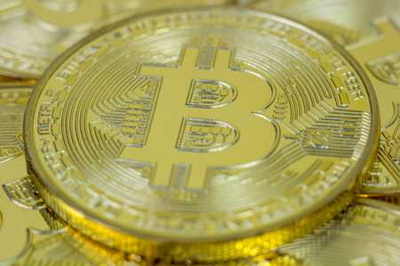decentralized: Photo Of Golden Bitcoin virtual currency coin.