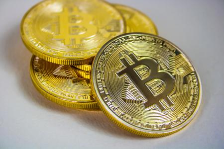 Photo Of Golden Bitcoin virtual currency coin.