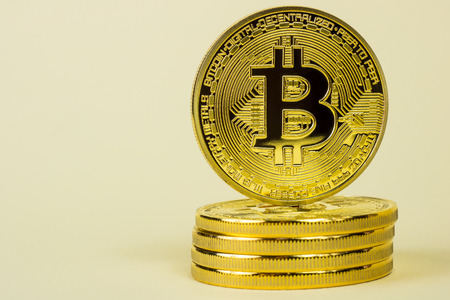 Photo Of Golden Bitcoin virtual currency coin.