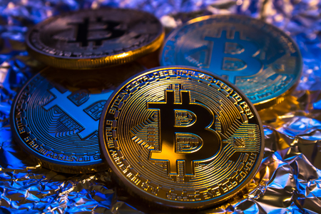 decentralized: Photo of cryptocurrency physical golden bitcoin coin on colorful background