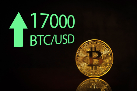 Bitcoin. arket bitcoin price record - seventeen thousand 17000 US dollars Stock Photo