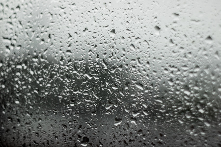 blur image background of water drop on car window and street background