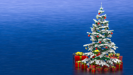 Beautiful decorated christmas tree with red present boxes in a blue background
