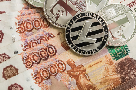 Silver crypto coins Litecoin LTC, Russian rubles. Metal coins are laid out in a smooth background to each other, close-up view from the top, crypto currency exchange of money. Фото со стока - 104622067
