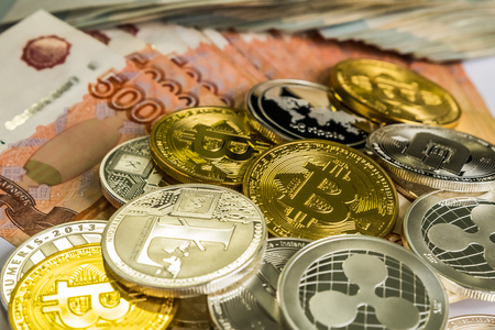 Silver Gold Crypto Coins litecoin LTC, bitcoin BTC, ripple XRP, dash . Russian ruble. Metal coins are laid out in a flat background, close-up view from the top, crypto currency exchange of money. Фото со стока