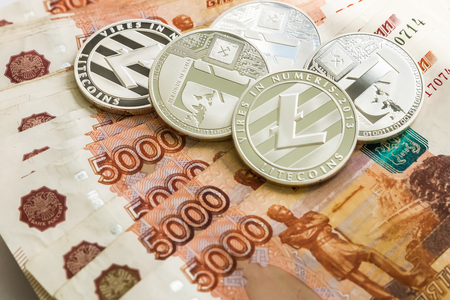 Silver crypto coins Litecoin LTC, Russian rubles. Metal coins are laid out in a smooth background to each other, close-up view from the top, crypto currency exchange of money. Фото со стока