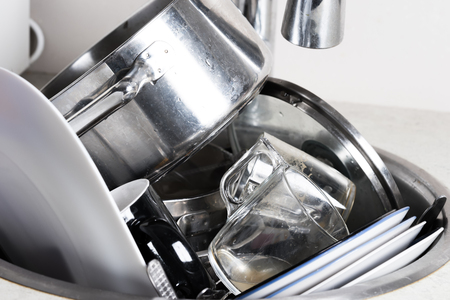unwashed: dirty dishes in the sink