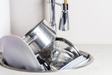 compulsive: dirty dishes in the sink
