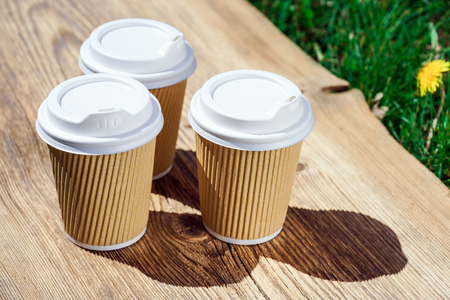 recycled paper coffee cup on wooden table