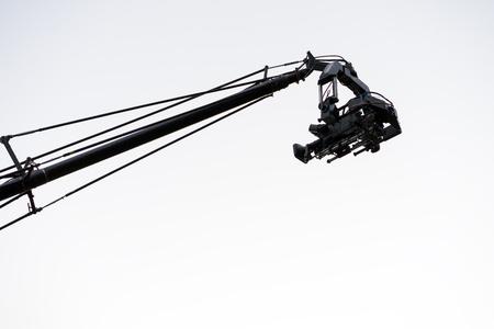 Live event video camera on crane over white Stock Photo
