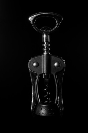 used corkscrew closeup on dark background black and white Stock Photo