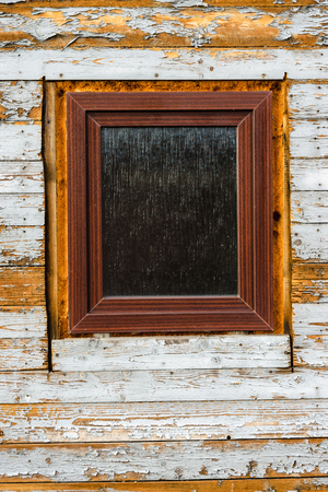 Windows installed in old wooden house, peeling paint on wooden planks, wearing texture