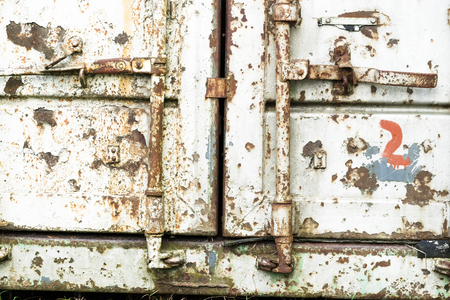 Old rusty shipping container locking system closeup