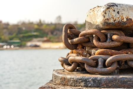 rusty anchor chain around the bollard