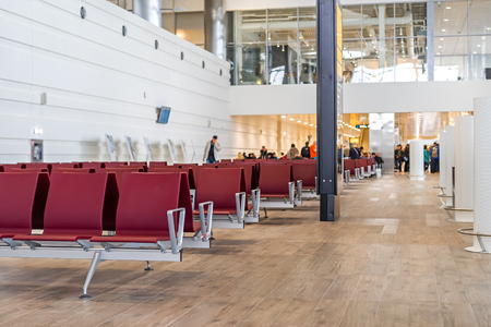 Airport terminal empty seats people on background Archivio Fotografico